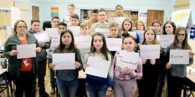 Sixth-graders with We Remember signs (2020)