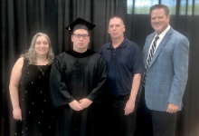Student with parents, superintendent
