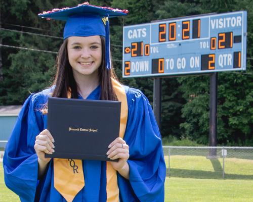 Avery Ostrander with diploma (6/2021)