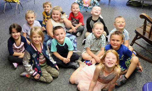 Kindergarten students smiling