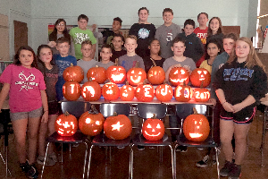 Sixth-graders with carved pumpkins 2019