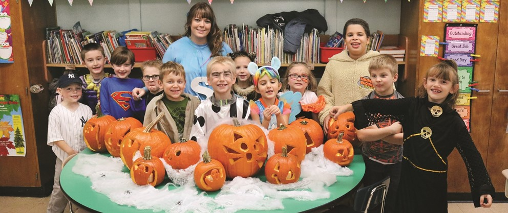Students smile with Halloween props