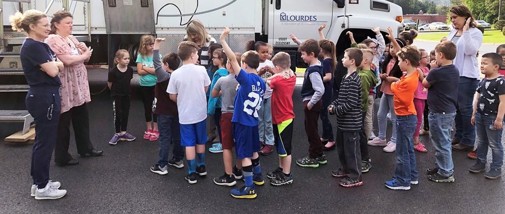 Hancock students at Lourdes Dental Van