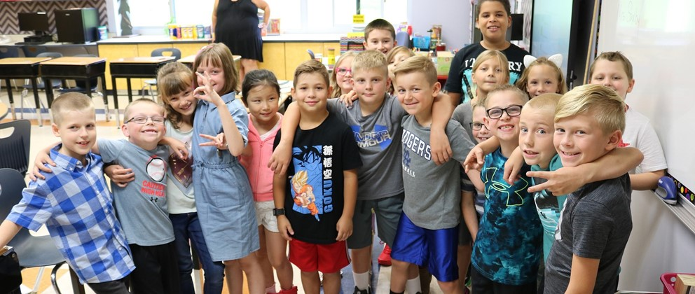 Elementary students pose on first day of school