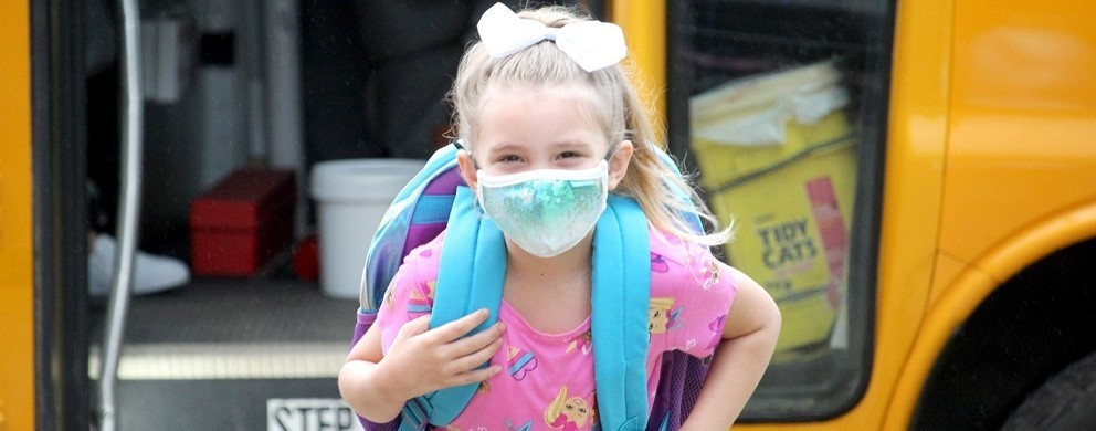 Young girl returns to school with mask (9/2020)