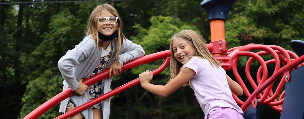 Two girls on playground (9/2021)
